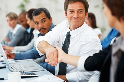 Buy stock photo Business man shaking hands with colleague during meeting