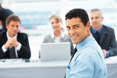 Buy stock photo Portrait of smart man smiling with panel of interviewers in background