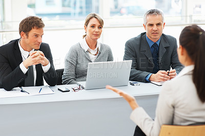 Buy stock photo Panel of interviewers in conversation with applicant