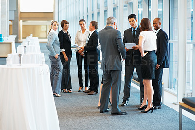 Buy stock photo Full length of colleagues discussing business matters with each other