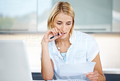 Buy stock photo Portrait of a confident young businesswoman working on contract paper at office