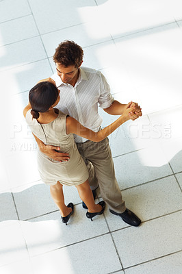 Buy stock photo Top view of attractive young man and woman couple dancing and holding hands