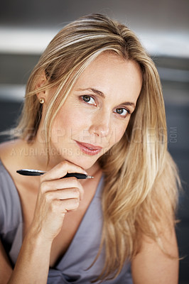 Buy stock photo Portrait of a beautiful young woman holding a pen looking happy