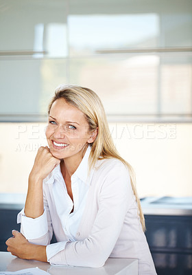 Buy stock photo Portrait of a relaxed young businesswoman sitting in office looking happy