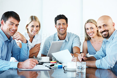 Buy stock photo Group of happy business associates in a meeting together at the office