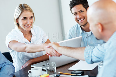Buy stock photo Portrait of successful businesspeople shaking hands in a meeting at office