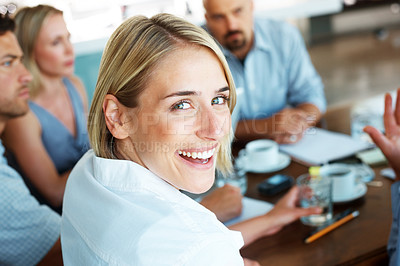 Buy stock photo Closeup portrait of smiling businesswoman in a meeting with her business colleague in the office