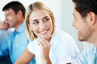 Buy stock photo Portrait of a pretty young woman interacting with her colleague during meeting at office