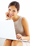 Pretty young woman sitting with laptop