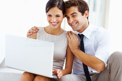 Buy stock photo Portraity of beautiful young business couple sitting on steps and working on laptop