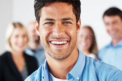 Buy stock photo Portrait of a handsome businessman laughing with his business colleague - Business group