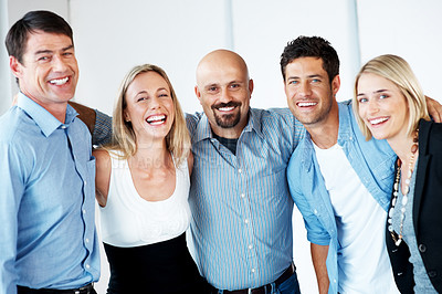 Buy stock photo Portrait of a joyful business team standing together and smiling