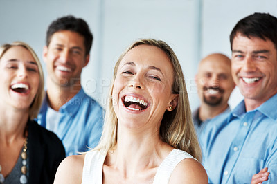 Buy stock photo Portrait of a beautiful young woman laughing with her successful team in background