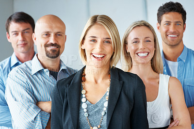 Buy stock photo Portrait of a cheerful businesswoman standing confidently in frount of her group at office