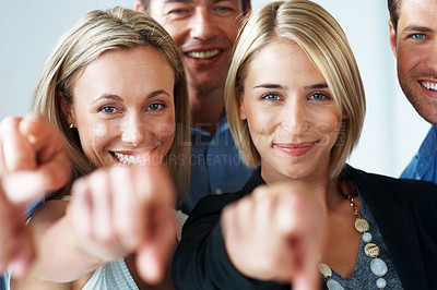Buy stock photo Portrait of a successful young business team smiling and pointing at you