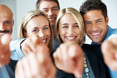 Buy stock photo Portrait of a sucessful team of business colleagues pointing at you and smiling
