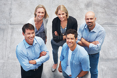 Buy stock photo Top view of happy team of business people standing together smiling and looking up