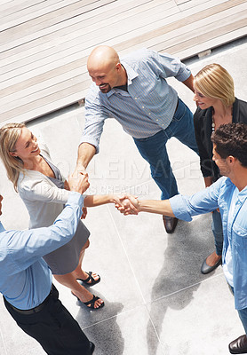Buy stock photo Top view of happy business people shaking hands with eachother