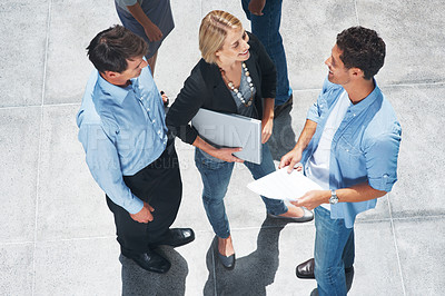 Buy stock photo Top view of group of business colleagues standing together and talking