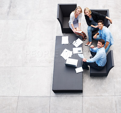Buy stock photo Top view of happy business people sitting together and looking upwards