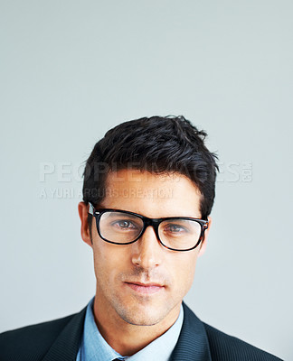 Buy stock photo Portrait of a trendy male executive wearing glasses on a white background below large copyspace