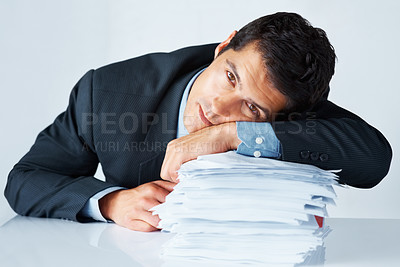 Buy stock photo View of man in suit resting on paperwork