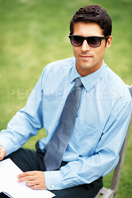 Buy stock photo View of man in shirt and tie with book outdoors