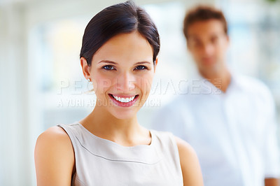 Buy stock photo Closeup portrait of a pretty young lady with her boyfriend in background