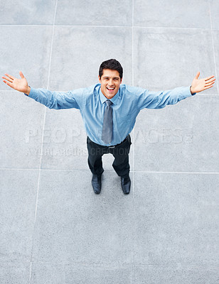 Buy stock photo Happy executive standing outside with arms outstretched