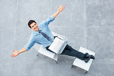 Buy stock photo Top view of executive working on laptop outside