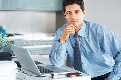 Buy stock photo View of businessman sitting in front of laptop