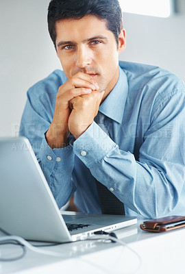 Buy stock photo Portrait of serious executive sitting in front of laptop