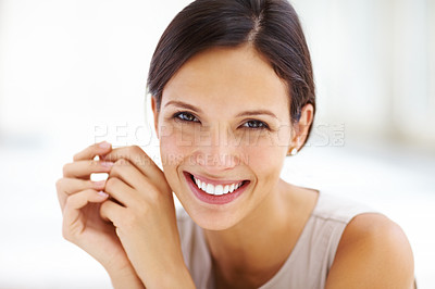 Buy stock photo Closeup portrait of an attractive young woman looking happy