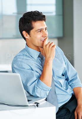 Buy stock photo Businessman sitting next to laptop and looking off into distance