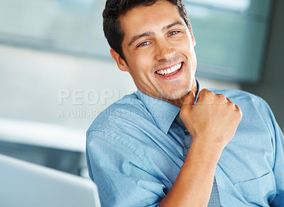 Buy stock photo Closeup of executive sitting and smiling while next to laptop