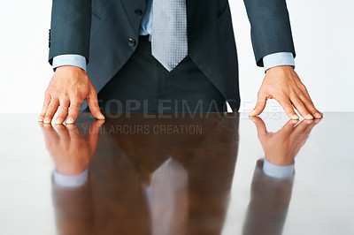 Buy stock photo Executive standing and leaning with fingers on table