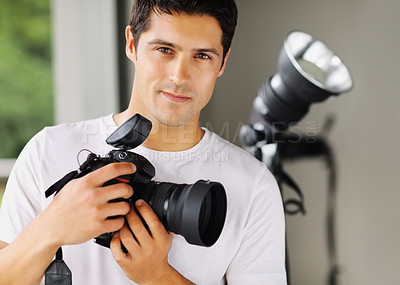 Buy stock photo A photographer holding his camera