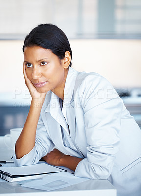 Buy stock photo View of business woman sitting at desk with hand on face