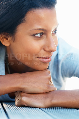 Buy stock photo Attractive woman resting chin on hands and looking into distance