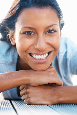 Buy stock photo Happy woman resting her chin on her hands