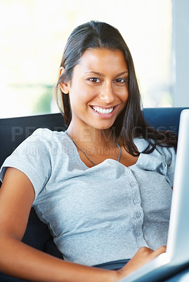 Buy stock photo Attractive woman sitting on sofa and working on laptop