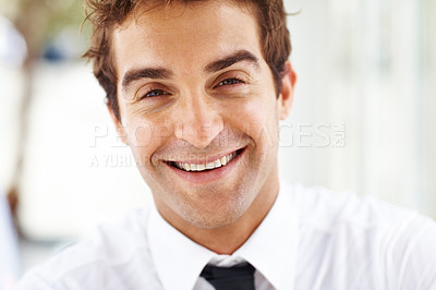 Buy stock photo Closeup portrait of smart young male entrepreneur smiling confidently