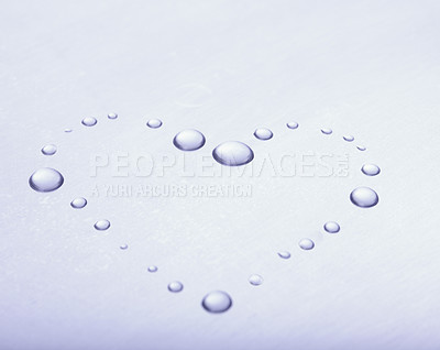 Buy stock photo Beautiful heart shape made by water droplets on shiny surface