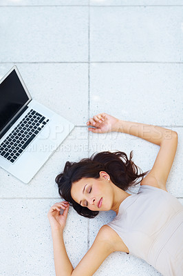 Buy stock photo Top view of sweet young lady sleeping on floor with a laptop - Copyspace