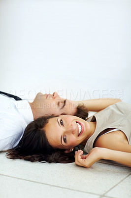 Buy stock photo Portrait of pretty young lady lying down on floor with her boyfriend sleeping - Copyspace