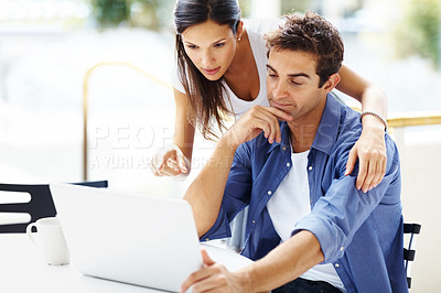 Buy stock photo Portrait of lovely young couple working on laptop - Copyspace