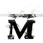 Letter M dropped into water