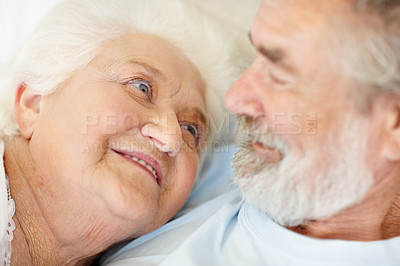 Buy stock photo A senior couple looking lovingly at one another
