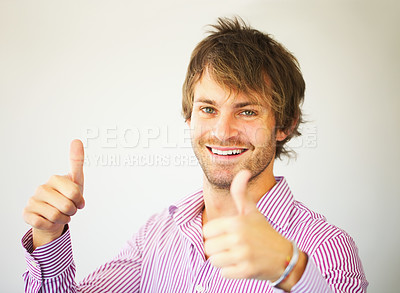 Buy stock photo Closeup of handsome business man giving you two thumbs up