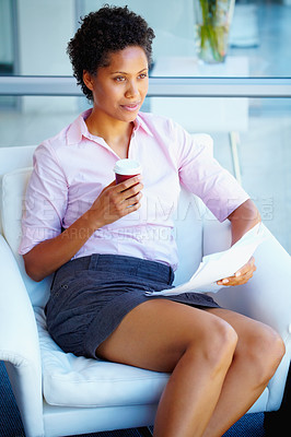 Buy stock photo Young business woman holding coffee and relaxing on couch